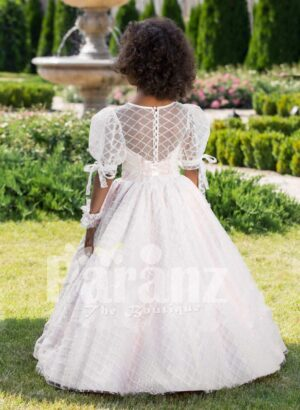 Light metallic pink sheer sleeve flared tulle skirt gown with rhinestone-lace work waistline back side view