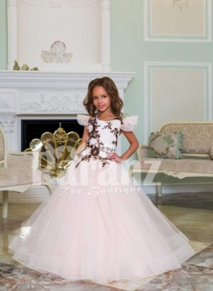 Light pink baby gown with flared and high volume tulle skirt and brown floral appliquéd bodice