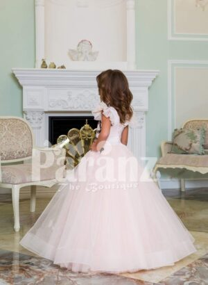 Light pink baby gown with flared and high volume tulle skirt and brown floral appliquéd bodice side view