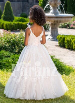 Light pink sleeveless baby party gown with rhinestone neckline and floor length tulle skirt back sidse view