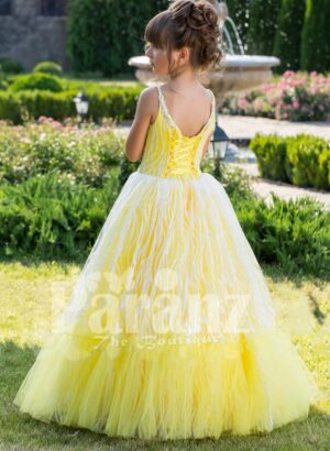 Light yellow sleeveless baby gown with rhinestone neckline and floor length tulle skirt back side view
