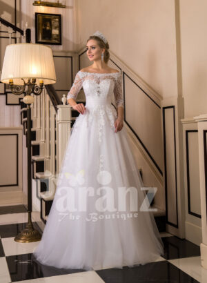 Off-shoulder pearl white floor length flared wedding tulle gown