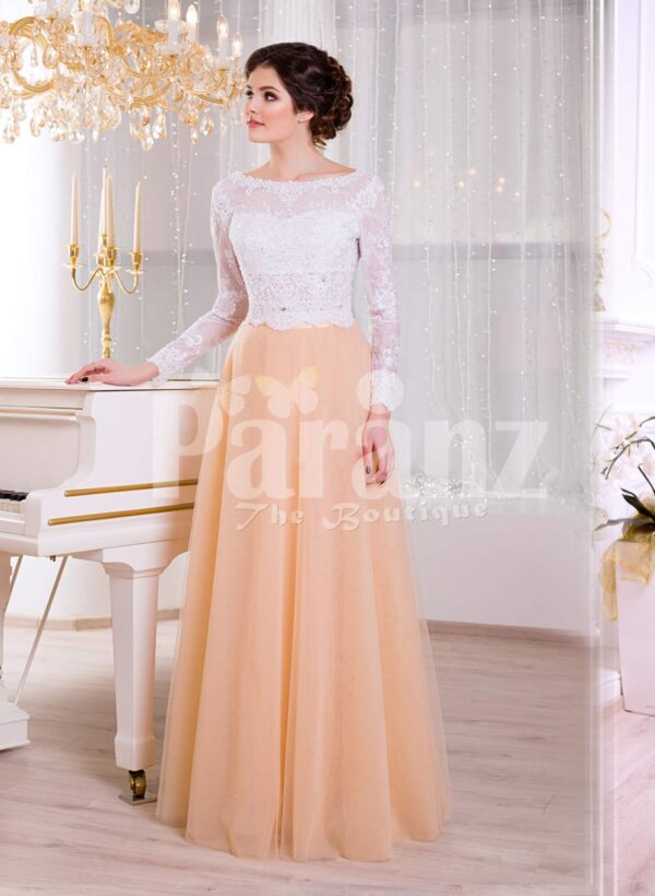 Paranz's floor length elegant evening gown with royal white bodice and peachy orange tulle skirt