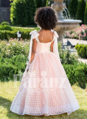 Peach pink unique sleeveless baby gown with flared tulle skirt and sheer overskirt back side view