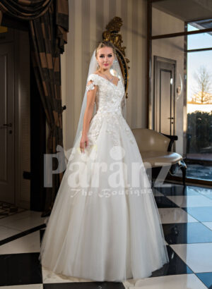 Pearl white cap sleeve floor length tulle wedding gown with floral bodice