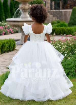 Pearl white floor length multi-layer tulle skirt baby gown with elite floral work bodice back side view