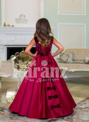 Purple velvet bodice exclusive baby gown with flared rich satin floor length gown in magenta back side view