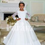 Rich pearl white floor length full sleeve baby gown with white elegant lace work