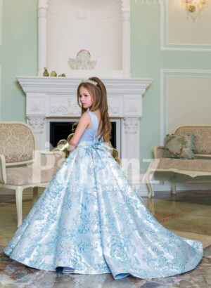 Rich satin shiny floor length baby gown with all over same hue floral appliqués in blue side view