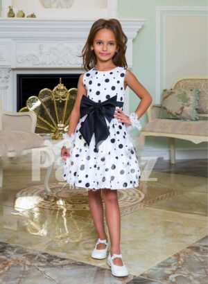 Rich satin sleeveless and sleek tea length party dress with black ball print all over