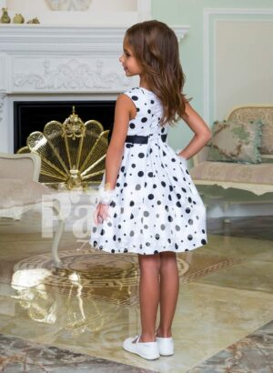 Rich satin sleeveless and sleek tea length party dress with black ball print all over back side view