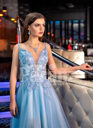 Sleeveless elegant blue evening gown with side slit tulle skirt and floral appliquéd royal bodice