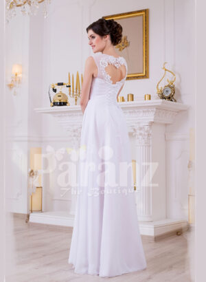 Sleeveless pearl white floor length tulle skirt wedding gown with lace appliquéd bodice back side view