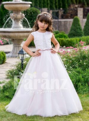 Small cap sleeve soft and lightweight light pink baby gown with flared tulle skirt