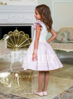Tea length rich satin party dress for girls with white lace work bodice and frilly sleeves side view