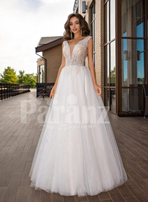 White floor length tulle wedding gown with glitz glam bodice