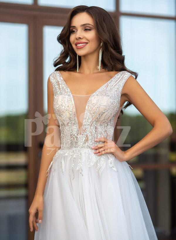 White floor length tulle wedding gown with glitz glam bodice close view
