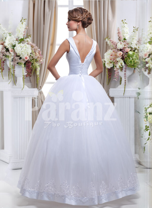 Women's Barbie style pearl white sleeveless wedding gown with high volume tulle skirt back side view