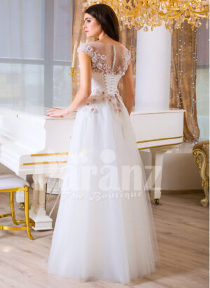 Women's beautiful white and pink rosette bodice elegant floor length tulle gown back side view