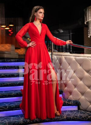 Women's bright red side slit evening satin gown with full sleeve bodice