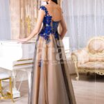 Women's brown-grey floor length tulle skirt evening gown with bright floral appliquéd bodice back side view