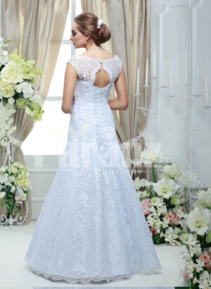 Women's elegant floor length sleeveless white satin gown with all over white lace work back side view