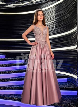Women's elegant metal pink evening gown with satin skirt and floral appliquéd bodice
