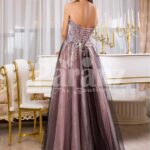 Women's elegant off-shoulder evening gown with long tulle skirt and rich appliquéd bodice back side view
