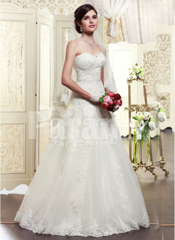 Women's elegant off-shoulder style wedding gown with flared and high volume tulle skirt