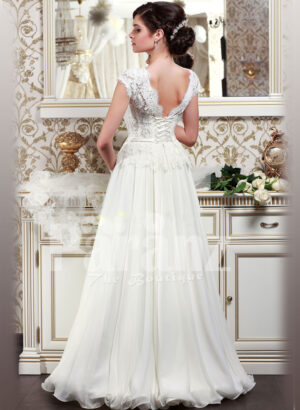 Women's elegant pearl white floor length wedding gown with super lacy bodice and tulle skirt back side view
