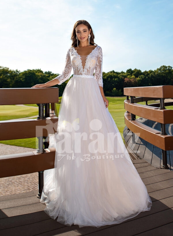 Women's elegant pearl white tulle wedding gown with royal bodice three quarter sleeves