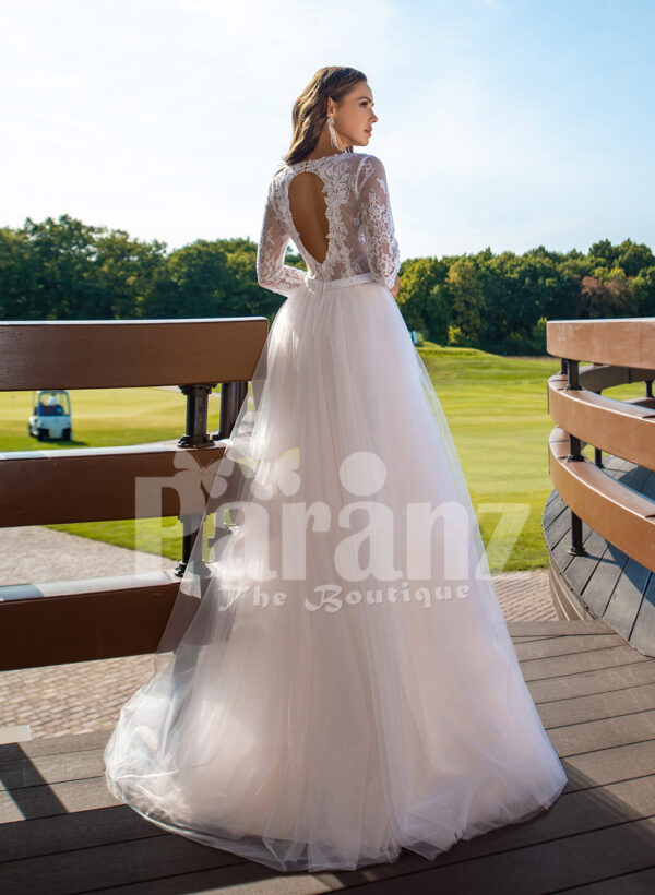 Women's elegant pearl white tulle wedding gown with royal bodice three quarter sleeves back side view
