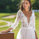Women's elegant pearl white tulle wedding gown with royal bodice three quarter sleeves close view