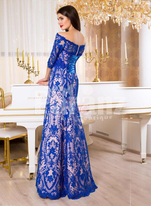 Women's elegant powder pink mermaid satin gown with bright blue lace cover all over back side view