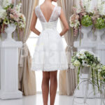 Women's elegant tea length rich satin wedding dress with rich rhinestone works back side view