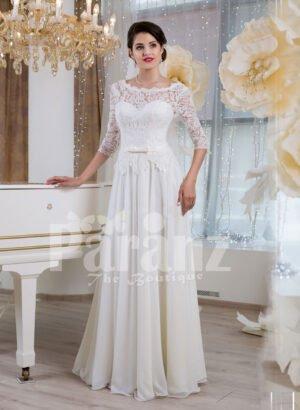 Women's elegant white lacy bodice floor length tulle skirt wedding gown