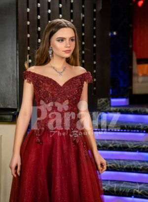 Women's exciting maroon evening gown with side slit skirt and royal rhinestone bodice