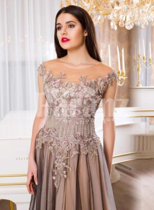 Women's exclusive evening gown with rich royal appliquéd bodice with floor length tulle skirt