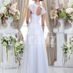 Women's floor length sleek satin wedding gown with floral lace work in white back side view