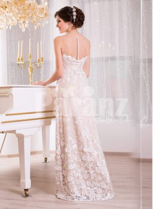 Women's floor length sleek tulle evening gown with all over white floral lace appliqués back side view