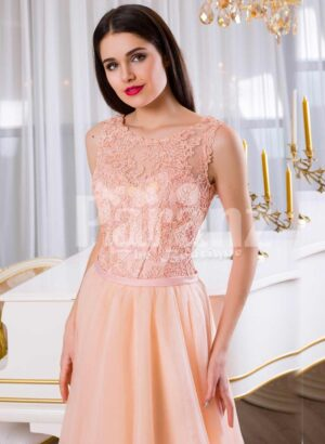 Women's floor length tulle skirt evening gown with appliquéd bodice in peach hue