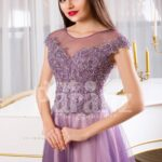 Women's floor length tulle skirt evening gown with royal rhinestone studded bodice in mauve