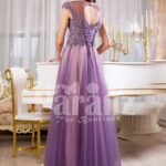 Women's floor length tulle skirt evening gown with royal rhinestone studded bodice in mauve back side view
