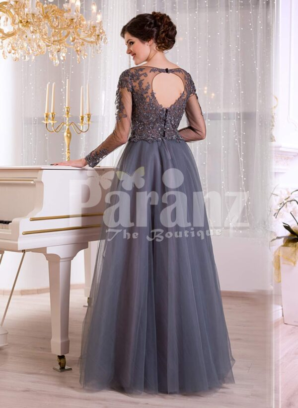 Women's full sheer sleeve evening party gown with flared and long tulle skirt in grey back side view
