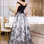 Women's glam black bodice floor length evening gown with silver tulle skirt back side view