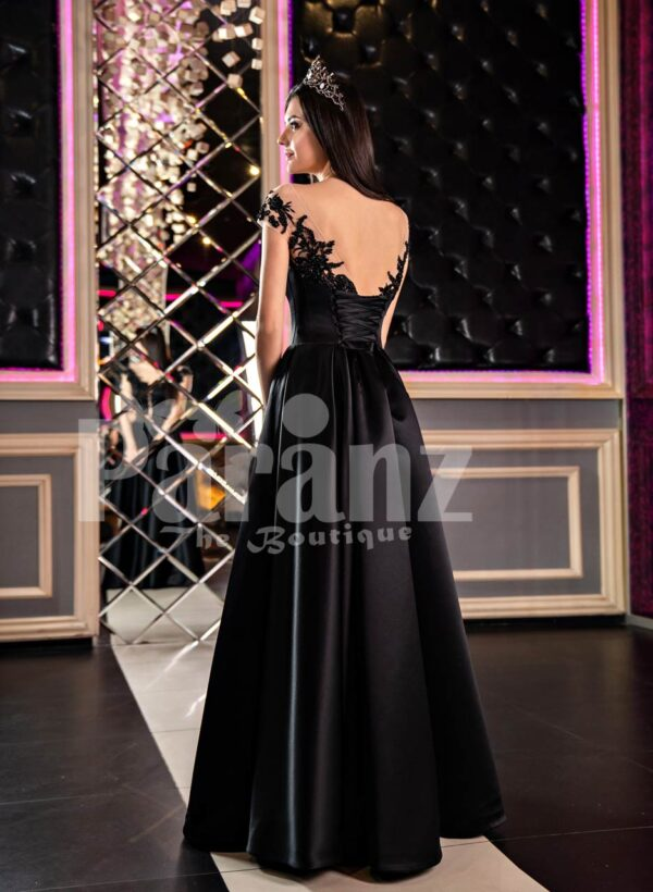 Women's glam black rich satin evening party gown with side slit skirt and lacy bodice back side view