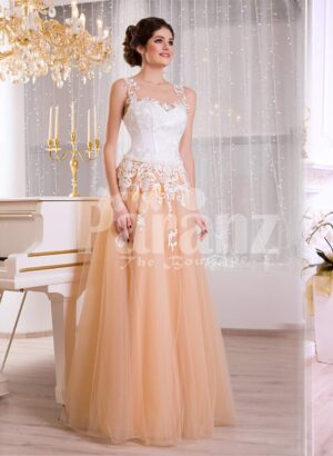Women's glam evening gown with peachy orange flared tulle skirt and appliquéd white bodice