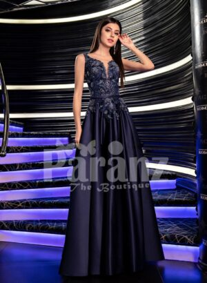Women's glam metal navy evening gown with flared satin skirt and royal appliquéd bodice