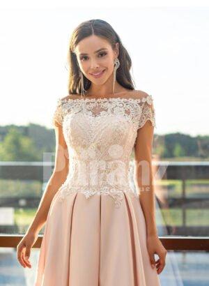 Women's high-low rich satin wedding dress with stunning appliquéd bodice close view