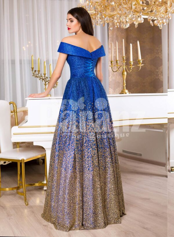 Women's high volume satin evening gown with tulle skirt underneath and off-shoulder bodice back side view